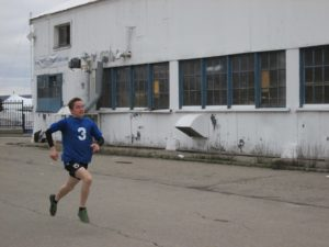 LS Barnard runs during a run and shoot competition