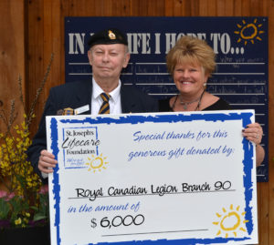 Mr. Begley presenting a check as the poppy chair representative of Branch 90 Legion to St. Joseph's Lifecare Foundation