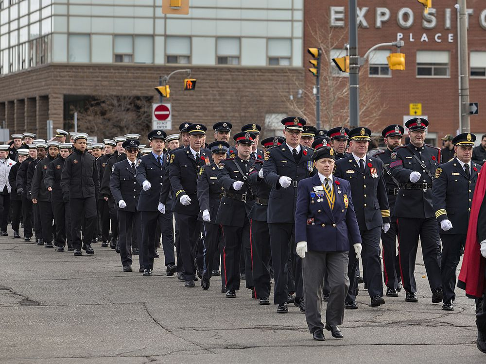 Veterans, police, fire personnel and cadets march along Dalhousie street on Sunday morning to the Brant County War Memorial - Brian Thompson/Brantford Expositor/Postmedia Network