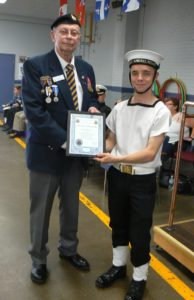Mr. Begley presenting an award to CPO Alex Barnard