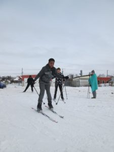 Forbes skiing in the ships parking lot