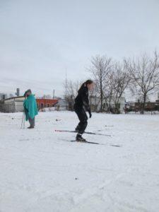 PO Barnard skiing in the ships parking lot