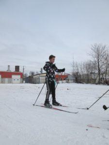 LS Barnard skiing in the ships parking lot