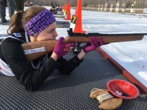 PO Barnard takes aim during biathlon competition