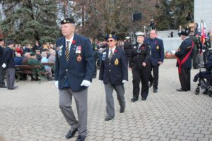 Mr. Begley leading wreath procession at the Remembrance Day Service
