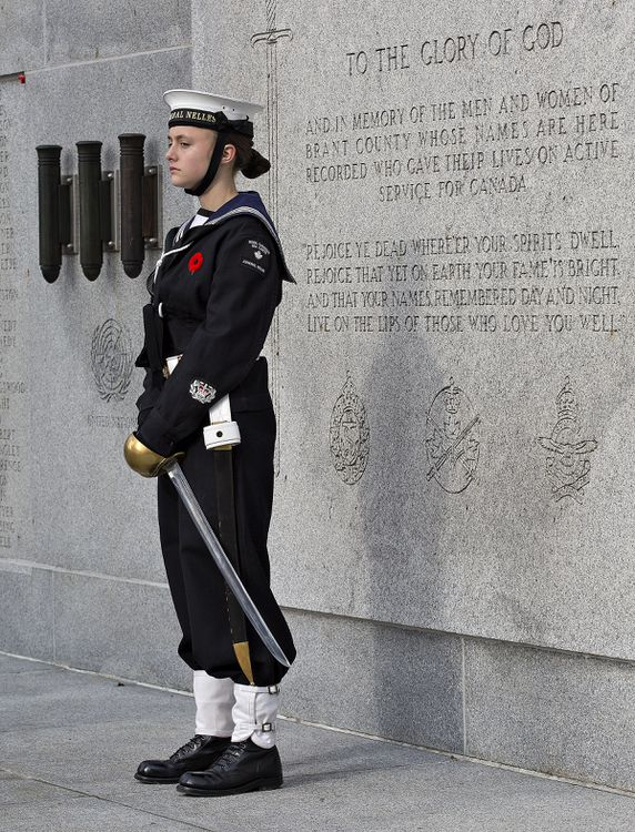 CPO2 C. Barnard stands on the Brant County War Memorial monument - Brian Thompson/Brantford Expositor/Postmedia Network