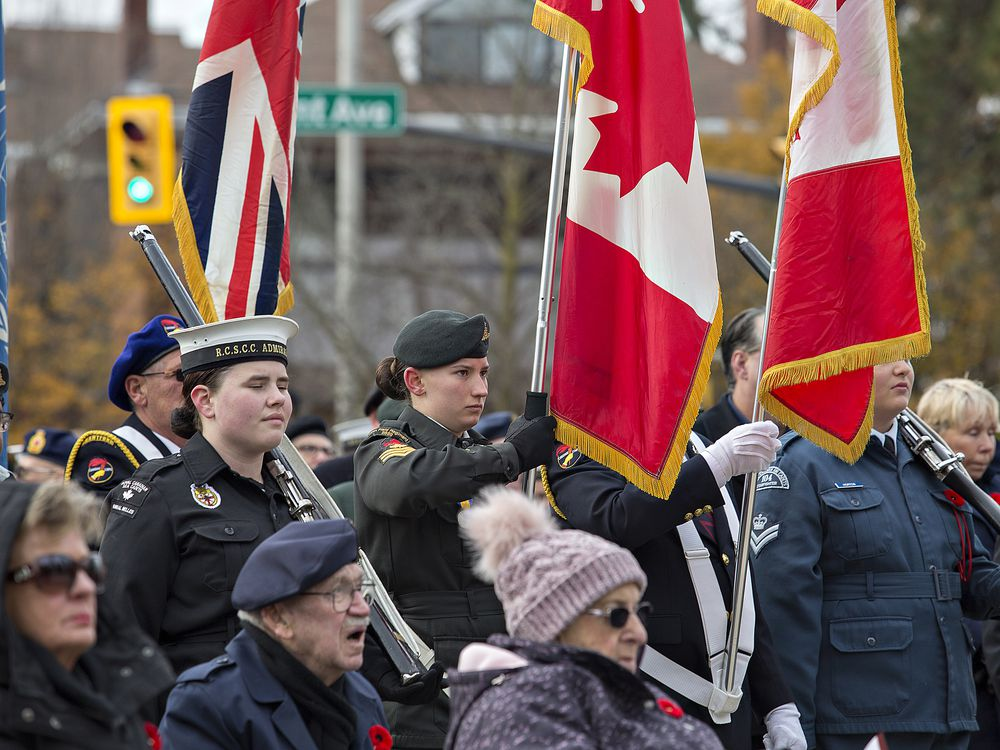 Cadets in a colour party hold flags during the Remembrance Day service - Brian Thompson/Brantford Expositor/Postmedia Network