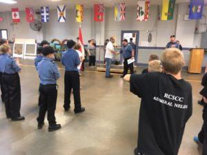 Lt (N) Messecar congratulates NCdt Robinson